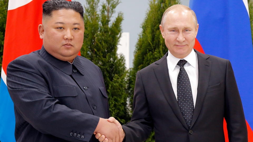 Russian President Vladimir Putin, right, and North Korea's leader Kim Jong Un shake hands during their meeting in Vladivostok, Russia, on April 25, 2019. (Alexander Zemlianichenko / Pool / AP)