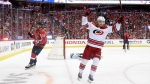 Carolina Hurricanes center Sebastian Aho (20), of Finland, celebrates his goal during the second period of Game 7 of an NHL hockey first-round playoff series next to Washington Capitals center Nicklas Backstrom (19), of Sweden, Wednesday, April 24, 2019, in Washington. The Hurricanes won 4-3 in double overtime. (AP Photo/Nick Wass)