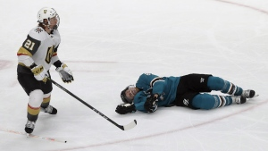 San Jose Sharks centre Joe Pavelski, right, lies on the ice next to Vegas Golden Knights centre Cody Eakin in San Jose, Calif., on April 23, 2019.  (Jeff Chiu / THE CANADIAN PRESS / AP)