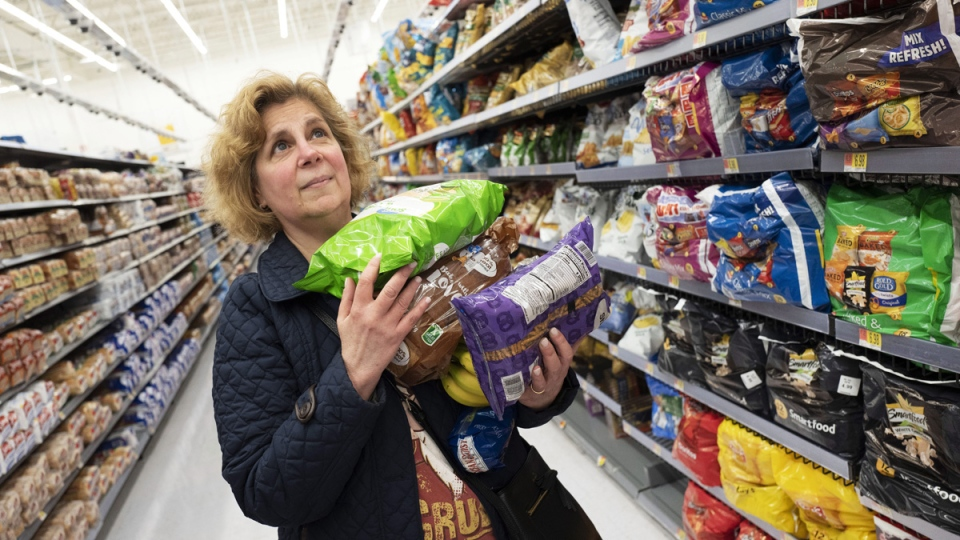 Marcy Seinberg shops at a Walmart Neighborhood Market, in Levittown, N.Y., on April 24, 2019. (Mark Lennihan / AP)