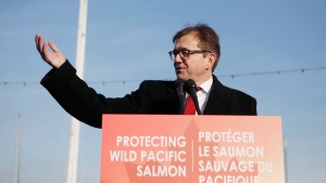 Federal Minister of Fisheries Jonathan Wilkinson speaks during an announcement with Premier John Horgan about the Salmon Restoration and Innovation Fund during a press conference at Fisherman's Wharf in Victoria, B.C., on Friday, March 15, 2019. Wilkinson today is announcing a total ban on all oil and gas activities, as well as mining, dumping of waste and bottom trawling, from all of Canada's marine protected areas. THE CANADIAN PRESS/Chad Hipolito
