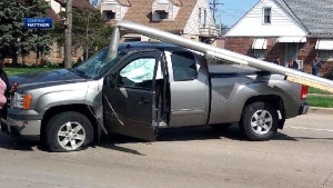 Driver survives after windshield impaled by pole