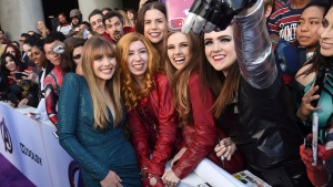"Elizabeth Olsen, left, takes a selfie with fans as she arrives at the premiere of ""Avengers: Endgame"" at the Los Angeles Convention Center on Monday, April 22, 2019. (Photo by Chris Pizzello/Invision/AP)"