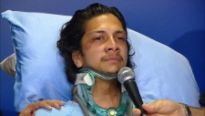 Navindra Sookramsingh speaks from a hospital bed on April 25, 2019. The 21-year-old suffered life-altering injuries in a hit-and-run in Brampton back in March. Police are still looking for the driver.