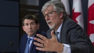 British Columbia Privacy Commissioner Michael McEvoy looks on as Canada's Privacy Commissioner Daniel Therrien (right) speaks during a news conference, Thursday, April 25, 2019 in Ottawa. THE CANADIAN PRESS/Adrian Wyld
