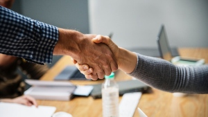 A recent survey in the U.K. found that a majority of respondents want a ban on physical contact in the workplace.