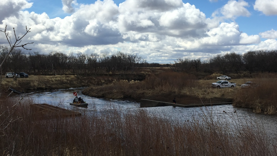 An RCMP dive team is working to recover the body of a man who fell into the Assiniboine River this week (Nathaniel Dove / CTV Yorkton)