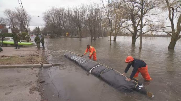 Barriers being put in place in place in Laval to protect homes.