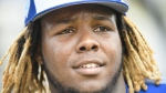 Toronto Blue Jays infielder Vladimir Guerrero Jr. (27) looks on at practice during baseball spring training in Dunedin, Fla., on Monday, February 18, 2019. CANADIAN PRESS/Nathan Denette