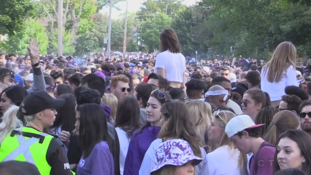 Police monitor a fake homecoming party on Broughdale Avenue in this file photo.