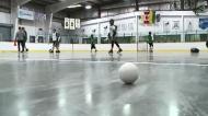 Rush player teaching lacrosse on Standing Buffalo