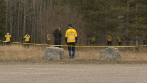 Search-and-rescue members search an area off Highway 66 in Kananaskis on April 25 in connection with the investigation into the disappearance of Jasmine Lovett and her daughter Aliyah