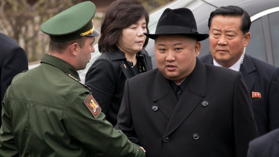 North Korean leader Kim Jong Un, center right, shakes hands with an honor guard officer before a wreath laying ceremony in Vladivostok, Russia, Friday, April 26, 2019. (AP Photo/Alexander Khitrov)