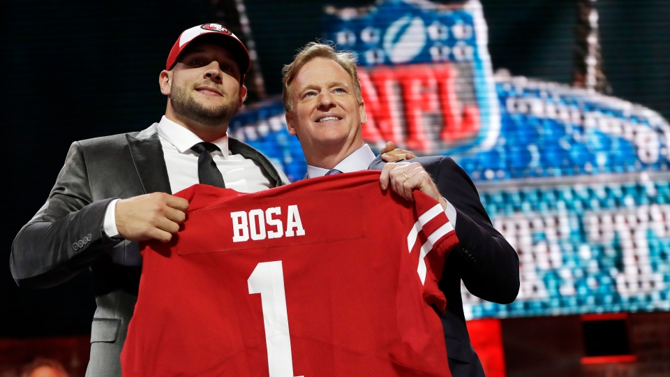 Ohio State defensive end Nick Bosa poses with NFL Commissioner Roger Goodell after the San Francisco 49ers selected Bosa in the first round at the NFL football draft, Thursday, April 25, 2019, in Nashville, Tenn.(AP Photo/Mark Humphrey)
