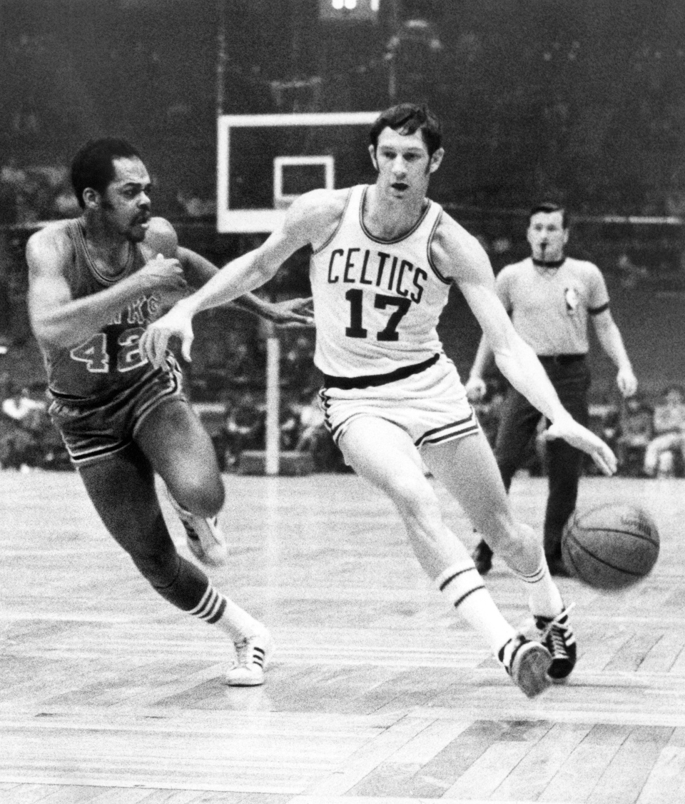 FILE - In this Jan. 8, 1970 file photo, Boston Celtics' John Havlicek (17) protects the ball with his body from Atlanta Hawks' Walt Hazzard (42) during an NBA basketball game in Boston. (AP Photo/File)