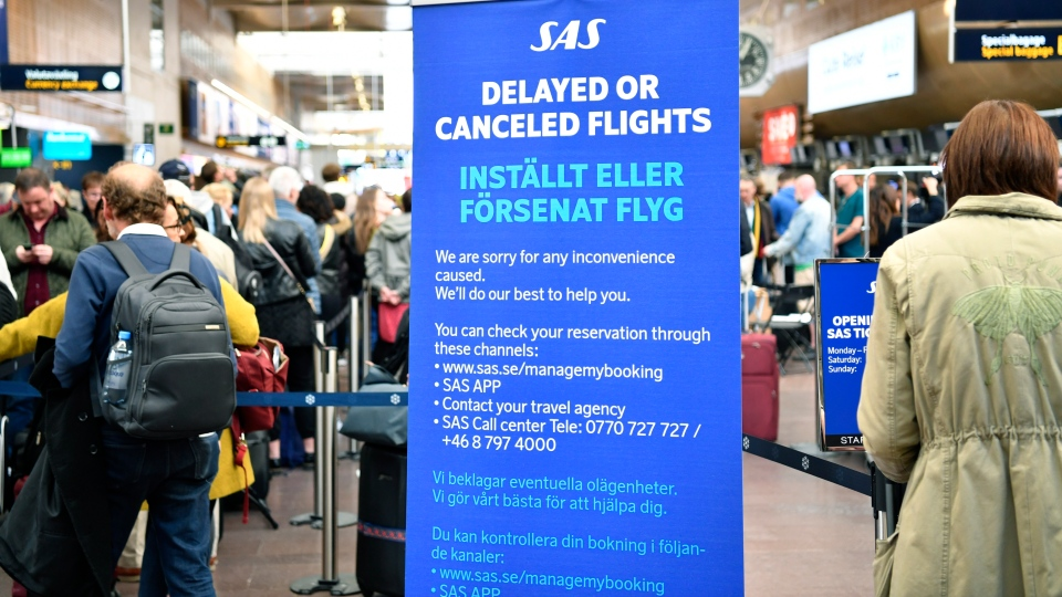 An information board informing about cancelled or delayed flights at Stockholm-Arlanda airport, Friday, April 26, 2019. (Henrik Montgomery/TT News Agency via AP)
