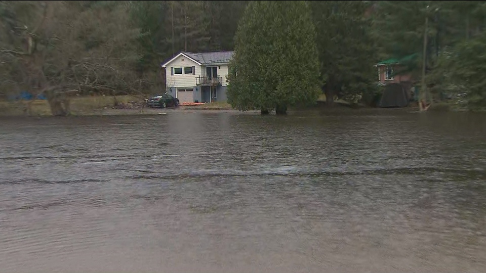 Rising waters are shown in Bracebridge on Friday morning. The town remains under a state of emergency amid flooding.