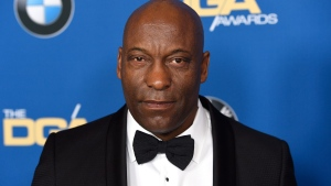 In this Feb. 3, 2018 file photo, John Singleton arrives at the 70th annual Directors Guild of America Awards in Beverly Hills, Calif. (Photo by Chris Pizzello/Invision/AP)