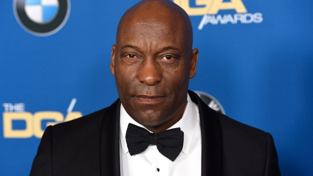 John Singleton's daughter denies the filmmaker is in a coma