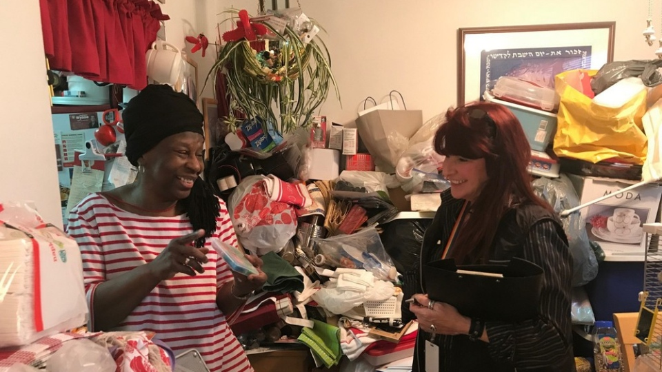 Trudy Huet, the lead facilitator of the Toronto Hoarding Support Services Network, works with former client and partner of THSSN, Yvonne Zilber, in her home. (Courtesy: VHA Home HealthCare)