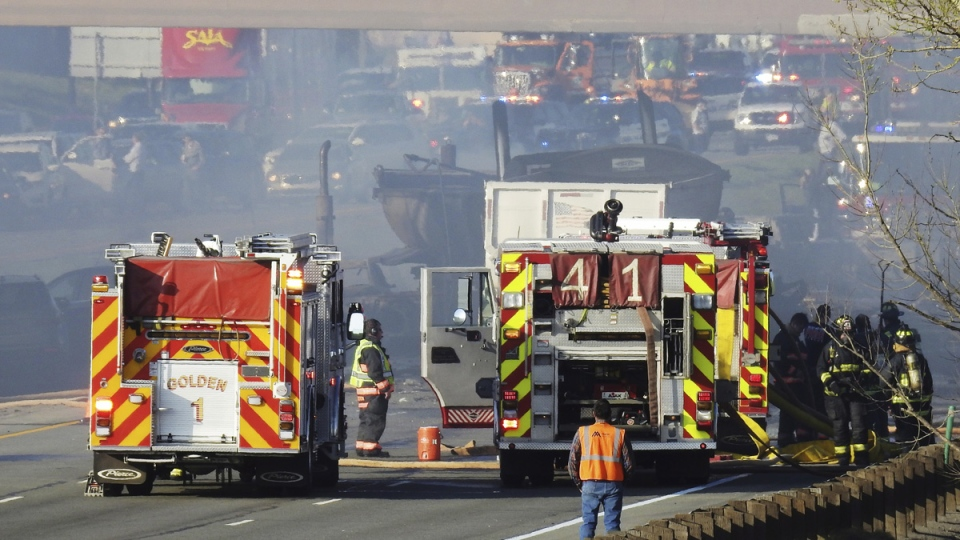 Emergency crews work at the scene of a deadly collision on Interstate 70 in Lakewood, Colo., on April 25, 2019. (Hyoung Chang / The Denver Post via AP)
