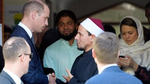 Prince William, top left, shakes hands with Imam Gamal Fouda after his visit to the Al Noor mosque in Christchurch, New Zealand, Friday, April 26, 2019. (Tracey Nearmy / Pool via AP)