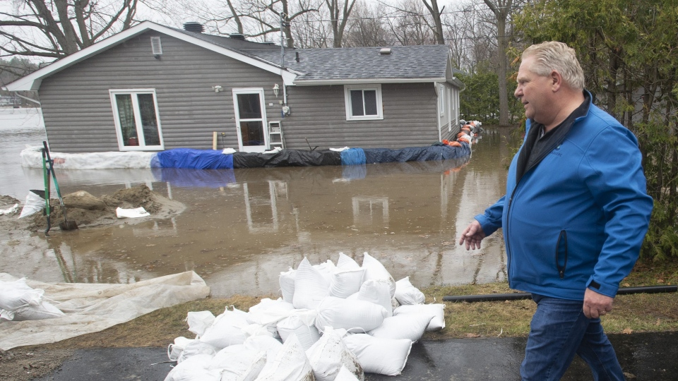 Ontario Premier Doug Ford surveys flooded areas on Friday, April 26, 2019 in Ottawa. THE CANADIAN PRESS/Adrian Wyld