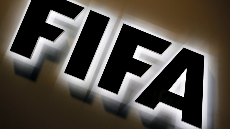 This Sept. 25, 2015 file photo shows the FIFA logo outside FIFA headquarters in Zurich, Switzerland. (AP Photo/Michael Probst, file)