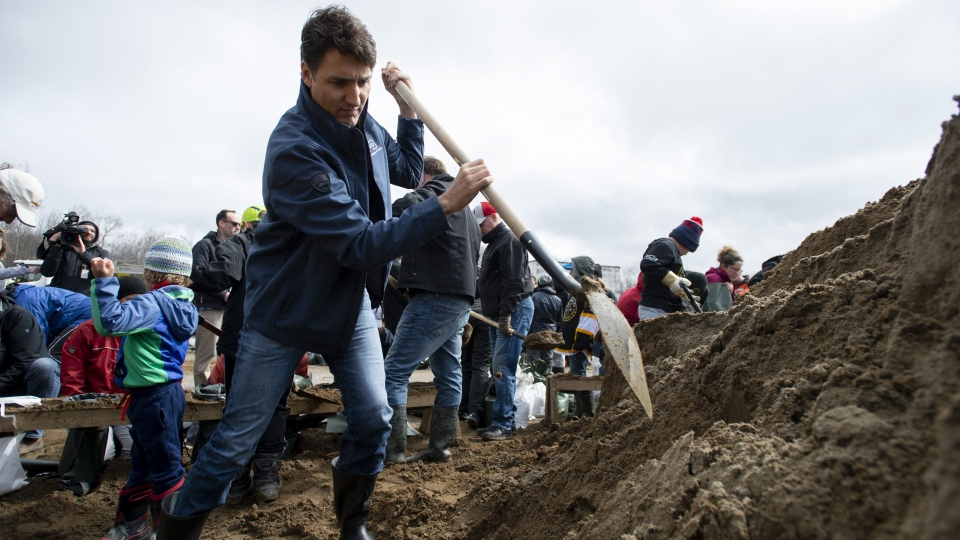 Prime Minister Justin Trudeau shovels sand to fill sandbags in the Ottawa community of Constance Bay, as flooding continues to affect the region on Saturday, April 27, 2019. THE CANADIAN PRESS/Justin Tang