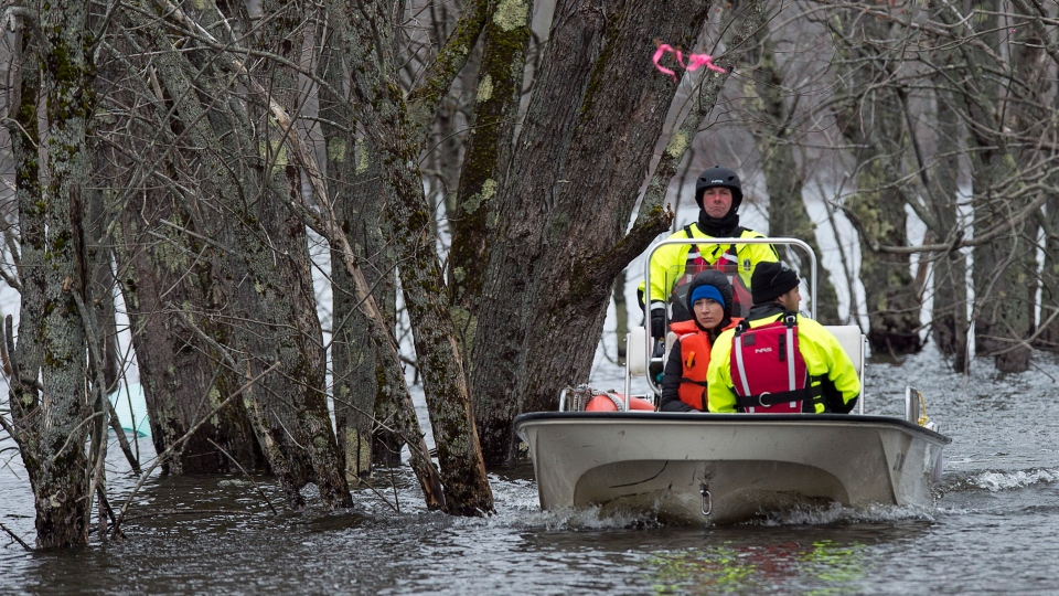An area resident is ferried from her home in Darlings Island, N.B. on Saturday, April 27, 2019. The area is cut off when the Kennebecasis River, a tributary of the Saint John River, rises above the road leading to the community. THE CANADIAN PRESS/Andrew Vaughan