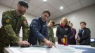 Prime Minister Justin Trudeau attends a briefing with members of the Canadian Forces on their response to flooding in the region, in the Ottawa community of Constance Bay on Saturday, April 27, 2019. THE CANADIAN PRESS/Justin Tang