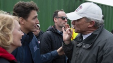 Prime Minister Justin Trudeau is confronted