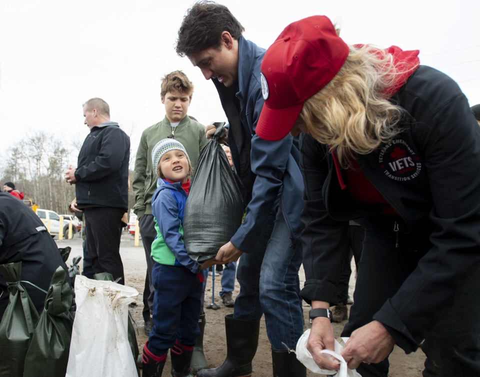 Prime Minister Justin Trudeau helps with flood relief efforts in Constance Bay, Ont., on Saturday, April 27, 2019.