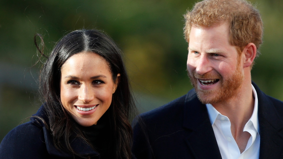 In this Dec. 1, 2017 file photo, Prince Harry and his then-fiancee Meghan arrive at Nottingham Academy in Nottingham, England. (AP Photo/Frank Augstein, File)