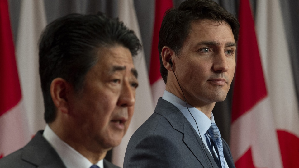 Canadian Prime Minister Justin Trudeau looks on as Japanese Prime Minister Shinzo Abe responds to a question during a visit on Parliament Hill in Ottawa, Sunday April 28, 2019. (THE CANADIAN PRESS / Adrian Wyld)