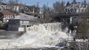 Dam in downtown Bracebridge Ontario can't hold back the swollen waters of the Muskoka River on Sunday, April 28, 2019. THE CANADIAN PRESS/Fred Thornhill