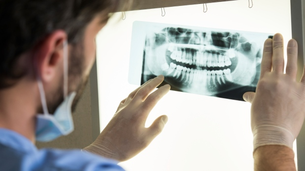 Dentist looking at scans