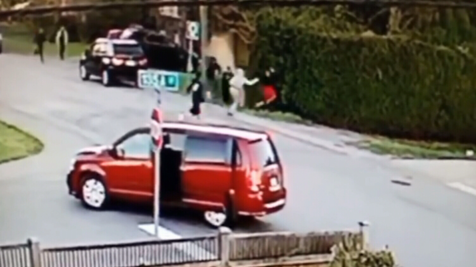 Men brawl in broad daylight at a Surrey, B.C. intersection on Saturday, April 27, 2019.