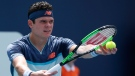 Milos Raonic, of Canada, prepares to serve to Kyle Edmund, of Britain, during the Miami Open tennis tournament, Sunday, March 24, 2019, in Miami Gardens, Fla. (AP Photo/Joel Auerbach)