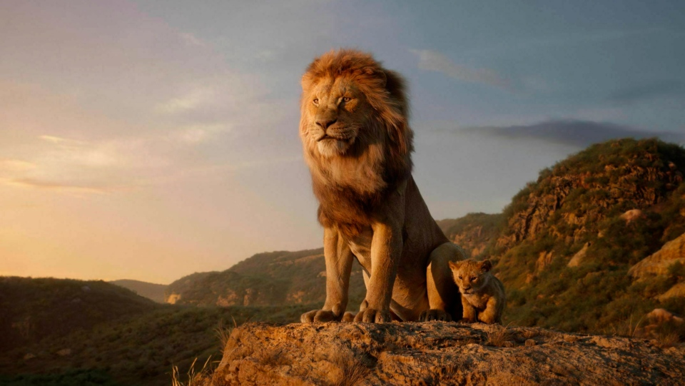 "This image released by Disney shows the characters Mufasa, voiced by James Earl Jones, left, and Simba, voiced by JD McCrary, in a scene from ""The Lion King,"" directed by Jon Favreau. (Disney via AP)"
