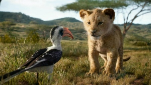 "This image released by Disney shows the characters Zazu, voiced by John Oliver, left, and Simba, voiced by JD McCrary, in a scene from ""The Lion King,"" directed by Jon Favreau. (Disney via AP)"