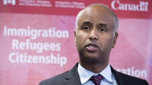 "Minister of Immigration Ahmed Hussen makes an announcement of support for pre-arrival services at the YMCA in Toronto on Monday, January 14, 2019. A backlog of ""legacy"" claims filed by refugee applicants to Canada who have been waiting over seven years for a hearing to find out if they can remain in Canada will soon be cleared. THE CANADIAN PRESS/Frank Gunn"