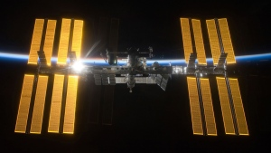 This March 25, 2009 photo provided by NASA shows the International Space Station seen from the Space Shuttle Discovery during separation. In the background is Earth's atmosphere seen as a blue arc. On Tuesday, April 30, 2019, NASA announced that a major power shortage at the station has delayed a SpaceX supply run later in the week. (NASA via AP)