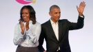 FILE - In this Oct. 31, 2017, file photo, former President Barack Obama, right, and former first lady Michelle Obama appear at the Obama Foundation Summit in Chicago. (AP Photo/Charles Rex Arbogast, File)