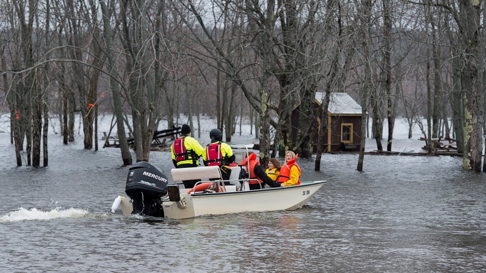 Area residents are ferried to their homes in Darlings Island, N.B. on Saturday, April 27, 2019. The area is cut off when the Kennebecasis River, a tributary of the Saint John River, rises above the road leading to the community. (THE CANADIAN PRESS/Andrew Vaughan)