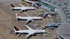 Planes are seen on the tarmac at YVR in this photo from April 2019. (Gary Barndt / CTV News Vancouver)
