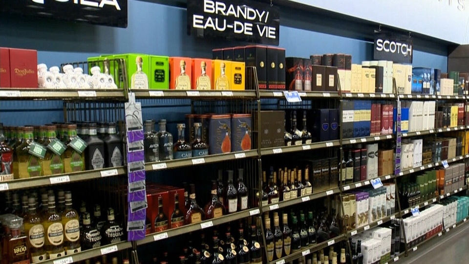 The Manitoba Liquor and Lotteries Corporation is being told to find opportunities for increased private-sector participation in liquor retail and distribution. (File image of bottles on display in a Liquor Mart.)