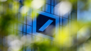 The headquarters of Deutsche Bank is seen through green leaves in Frankfurt, Germany, Tuesday, April 30, 2019. (AP / Michael Probst)