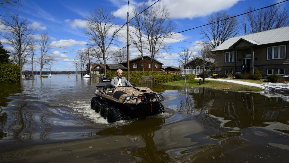 A resident makes his way along Morin Road though floodwaters from the Ottawa River in Cumberland, Ontario on Tuesday, April 30, 2019. THE CANADIAN PRESS/Sean Kilpatrick