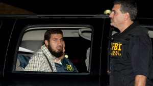 FILE - In this Sept. 19, 2009 file photo, terrorism suspect Najibullah Zazi is seated in an FBI vehicle after being arrested by the FBI in Aurora, Colo. (Chris Schneider/The Denver Post via AP, File)